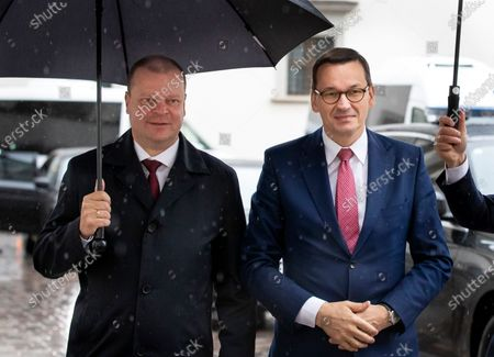 Lithuania's Prime Minister Saulius Skvernelis, left, and Poland's Prime Minister Mateusz Morawiecki pose for photographers prior to their meeting at the Palace of the Grand Dukes of Lithuania in Vilnius, Lithuania