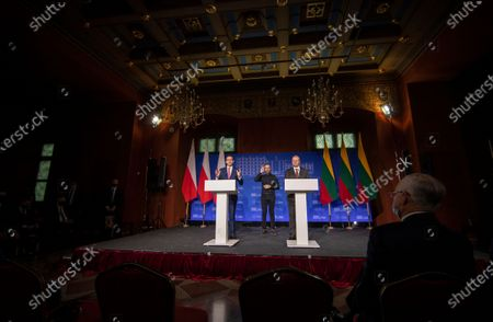 Stock Photo of Poland's Prime Minister Mateusz Morawiecki, right, speaks as Lithuania's Prime Minister Saulius Skvernelis listens during a news conference following joint meeting of the government of the Lithuania and the government of the Poland at the Palace of the Grand Dukes of Lithuania in Vilnius, Lithuania