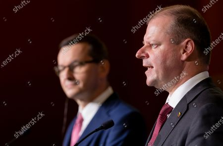 Stock Picture of Lithuania's Prime Minister Saulius Skvernelis, right, speaks as Poland's Prime Minister Mateusz Morawiecki listens during a news conference following joint meetings of the government of the Lithuania and the government of the Poland at the Palace of the Grand Dukes of Lithuania in Vilnius, Lithuania