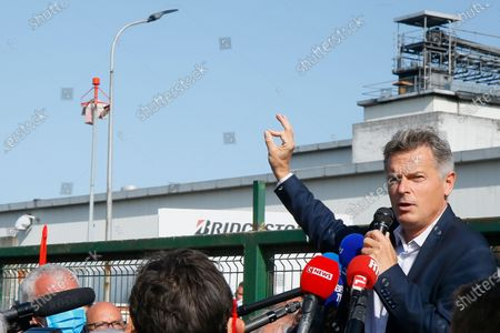 Communist party parliament member Fabien Roussel addresses Bridgestone employees outside the tire factory of Bethune, northern France, Thursday, Sept.17, 2020. Workers protest over the Japan-based company's decision to close the plant and lay off all its nearly 900 workers. Bridgestone argues the factory is no longer competitive globally, but unions and French politicians accused the company of using the virus-driven economic crisis as a pretext for the closure and not investing in modernizing the plant instead