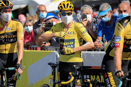 Slovenia's Primoz Roglic, wearing the overall leader's yellow jersey, center, and teammate Netherland's Tom Dumoulin, left, prepare for the start of stage 18 of the Tour de France cycling race over 175 kilometers (108.7 miles) from Meribel to La Roche-sur-Foron, France