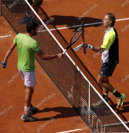 Denis Shapovalov of Canada (R) and Pedro Martinez of Spain greet after their second round match at the Italian Open in Rome, Italy, 17 September 2020.