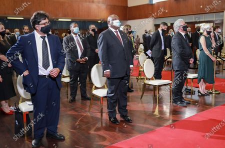 South African president Cyril Ramaphosa (C) attends  the funeral of George Bizos at the Hellenic Cultural Centre in Johannesburg, South Africa 17 September 2020. The late human rights lawyer and activist George Bizos represented Nelson Mandela during the Rivonia Trial. He was honoured with a special official funeral followed by a burial at Westpark Cemetery after passing away 09 September 2020 at the age of 92.