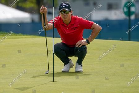 Ryo Ishikawa, of Japan, lines up a putt on the eighth green during the first round of the US Open Golf Championship, in Mamaroneck, N.Y