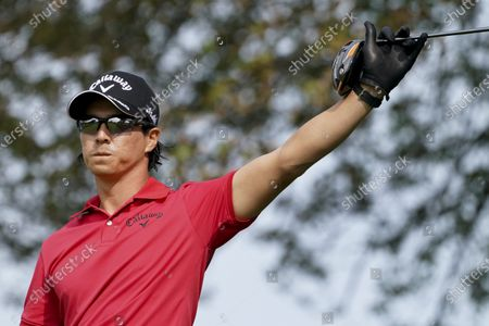 Ryo Ishikawa, of Japan, reacts after playing his shot from the ninth tee during the first round of the US Open Golf Championship, in Mamaroneck, N.Y