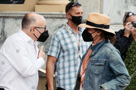 The actress Gina Gershon arrives at the Hotel María Cristina and is received by the director of the festival Jose Luis Rebordinos