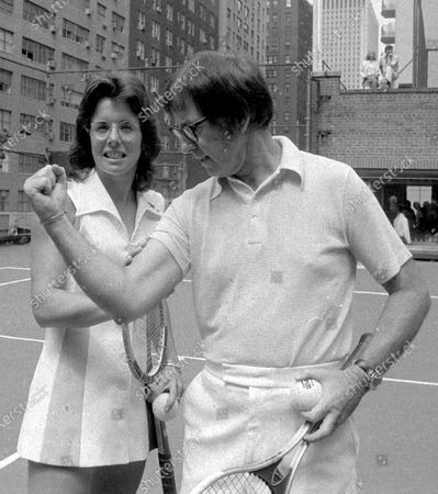 """Bobby Riggs poses for Billie Jean King. King won 12 Grand Slam singles titles, including six at Wimbledon, but her most famous match came in 1973 when she beat 55-year-old Bobby Riggs 6-4, 6-3, 6-3 in the """"Battle of the Sexes."""" The Fed Cup is changing its name to honour tennis great Billie Jean King, becoming The Billie Jean King Cup, the first major global team competition to be named after a woman, it is announced"""