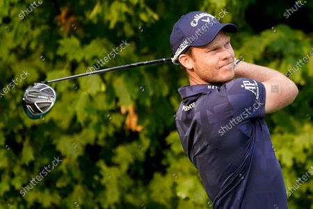 Stock Photo of Danny Willett, of England, drives off the 12th tee during the first round of the US Open Golf Championship, in Mamaroneck, N.Y
