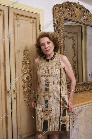 Raffaella Curiel wearing a dress with a Milan Cathedral print