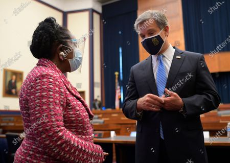 Rep. Sheila Jackson Lee, D-Texas, talks to Federal Bureau of Investigation Director Christopher Wray after he had testified before the House Homeland Security Committee hearing on 'worldwide threats to the homeland', on Capitol Hill Washington