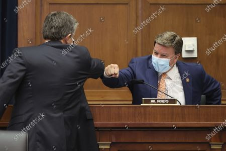 Federal Bureau of Investigation Director Christopher Wray, left, greets committee ranking member Rep. Mike Rogers, R-Ala., before a House Committee on Homeland Security hearing on 'worldwide threats to the homeland', on Capitol Hill Washington
