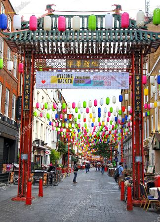 Colourful rainbow lanterns and Welcome back to Chinatown banner above the streets. Chinatown London in partnership with the London Chinatown Chinese Association (LCCA) has replaced the area's iconic red lanterns with thousands of special rainbow coloured lanterns. The rows of vibrantly coloured lanterns throughout the streets of Chinatown are part of the #LoveChinatown campaign, to support the community of Chinatown businesses and safely welcome people back to the area. The rainbow has also been a symbol of support throughout the pandemic to the UK's wonderful key workers.