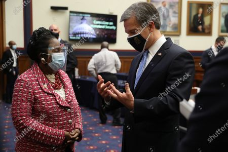 Wearing a face masks to reduce the risk posed by the coronavirus, Rep. Sheila Jackson Lee (D-TX) (L) talks about the Black Lives Matter movement with Federal Bureau of Investigation Director Christopher Wray following a hearing of the House Homeland Security Committee on 'worldwide threats to the homeland' in the Rayburn House Office Building on Capitol Hill in Washington, DC, USA, 17 September 2020. Committee Chairman Bennie Thompson (D-MS) said he would issue a subpoena for acting Homeland Security Secretary Chad Wolf after he did not show for the hearing. An August Government Accountability Office report found that Wolf's appointment by the Trump Administration, which has regularly skirted the Senate confirmation process, was invalid and a violation of the Federal Vacancies Reform Act.