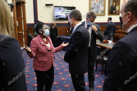 Wearing a face masks to reduce the risk posed by the coronavirus, Rep. Sheila Jackson Lee (D-TX) (C-L) talks about the Black Lives Matter movement with Federal Bureau of Investigation Director Christopher Wray (C-R) following a hearing of the House Homeland Security Committee on 'worldwide threats to the homeland' in the Rayburn House Office Building on Capitol Hill in Washington, DC, USA, 17 September 2020. Committee Chairman Bennie Thompson (D-MS) said he would issue a subpoena for acting Homeland Security Secretary Chad Wolf after he did not show for the hearing. An August Government Accountability Office report found that Wolf's appointment by the Trump Administration, which has regularly skirted the Senate confirmation process, was invalid and a violation of the Federal Vacancies Reform Act.
