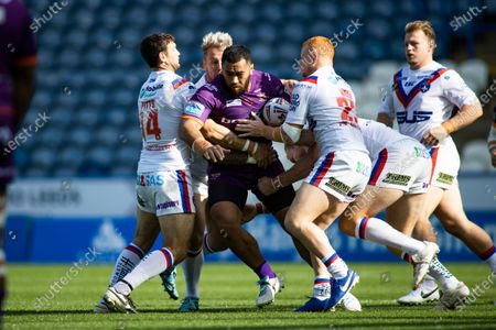 Stock Image of Suaia Matagi of Huddersfield is tackled by Jay Pitts, Joe Westerman and Josh Wood of Wakefield.