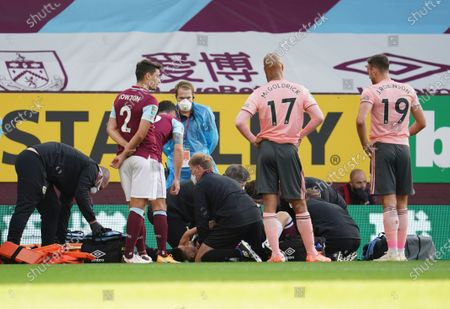 Burnley's Johann Berg Gudmundsson receives medical treatment during the English League Cup soccer match between Burnley and Sheffield United at the Turf Moor stadium in Burnley, England