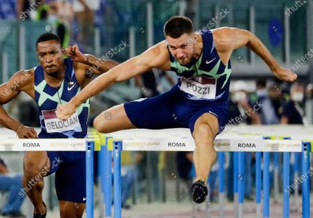 Great Britain's Andrew Pozzi, right, in action, in front of France's Willhelm Belgian, to win the men's 110m hurdles competition at the Golden Gala Pietro Mennea IAAF Diamond League athletics meet in Rome