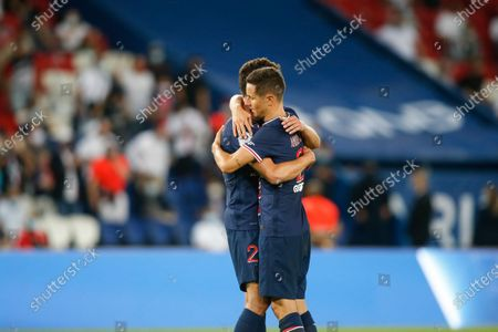 Stock Picture of PSG's German midfielder Julian Draxler (background) is congratulated by his teammate Spanish midfielder Ander Herrera after scoring the only one goal in the last minute of the French L1 football match between Paris Saint-Germain (PSG) and FC Metz, at the Parc des Princes stadium