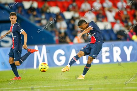 PSG's young defender fires the ball on goal in presence of his teammate Ander Herrera (L) during the French L1 football match between Paris Saint-Germain (PSG) and FC Metz, at the Parc des Princes stadium