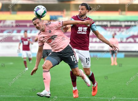 Sheffield's Phil Jagielka (L) in action against Burnley's Jay Rodriguez (R) during the English Carabao Cup second round match between Burnley and Sheffield United in Burnley, Britain, 17 September 2020.