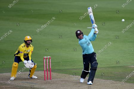 Jason Roy of Surrey plays a shot which is caught by Ian Holland off the bowling of /h3