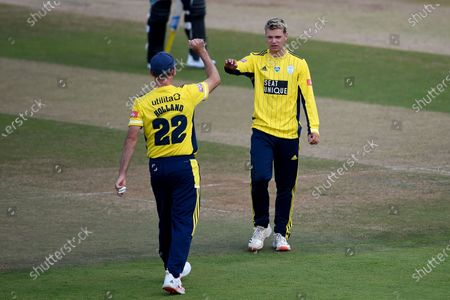 Felix Organ (right) and Ian Holland celebrate the wicket of Jason Roy