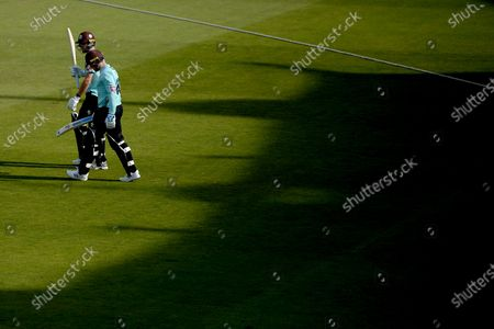 Will Jacks and Jason Roy of Surrey walk out to open the batting for surrey in the late summer sun