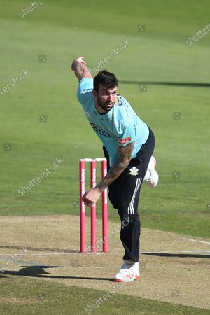 Reece Topley of Surrey bowling