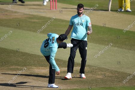 Reece Topley and Jason Roy of Surrey celebrate the wicket of George Munsey