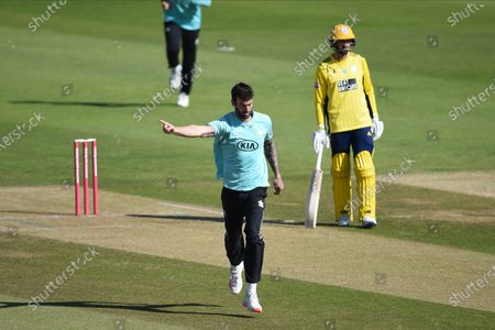 Reece Topley of Surrey celebrates the wicket of George Munsey