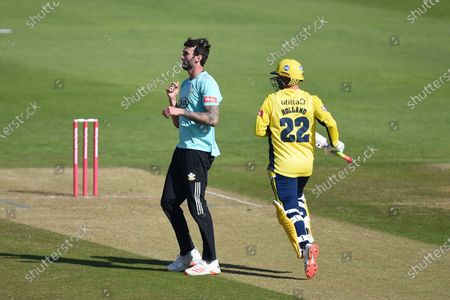 Ian Holland of Hampshire runs a single off the bowling of Reece Topley