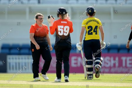 Charlotte Taylor and Carla Rudd of Southern Vipers celebrate the wicket of /e24