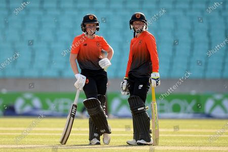 Emily Windsor (left) and Carla Rudd of Southern Vipers between overs