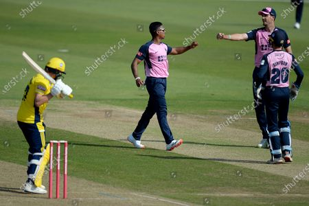 Stock Image of Thlan Walallawita, Steven Finn and John Simpson of Middlesex celebrate the wicket of Sam Northeast