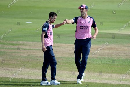 Nathan Sowter and Steven Finn of Middlesex celebrate the wicket of Joe Weatherley