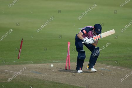 John Simpson of Middlesex is bowled by Shaheen Afridi,