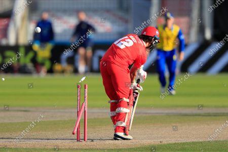 Rob Jones (12) of Lancashire Lightning is clean bowled by Matthew Potts (35) of Durham