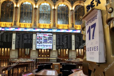 A calendar marks the date as several screens show the activity at the end of the session inside Spain's Stock Exchange main headquarters in Madrid, central Spain, 17 September 2020.