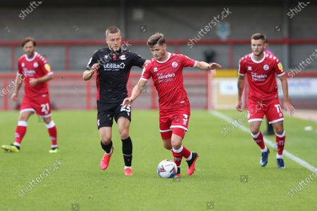 Stock Image of Scunthorpe's Frank Vincent vies for the ball against Crawley Town's Josh Doherty  during the Sky Bet League Two match between Crawley Town and Scunthorpe United at the PeopleÕs Pension Stadium in Crawley . 19 September 2020
