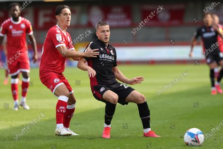 Crawley Town's Tom Nichols and Scunthorpe's Frank Vincent  during the Sky Bet League Two match between Crawley Town and Scunthorpe United at the PeopleÕs Pension Stadium in Crawley . 19 September 2020