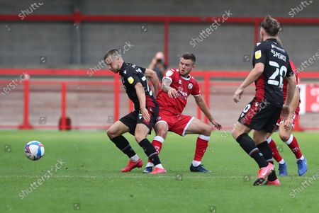 Stock Photo of Crawley Town's Tyler Frost vies for the ball against  Scunthorpe's Frank Vincent  during the Sky Bet League Two match between Crawley Town and Scunthorpe United at the PeopleÕs Pension Stadium in Crawley . 19 September 2020