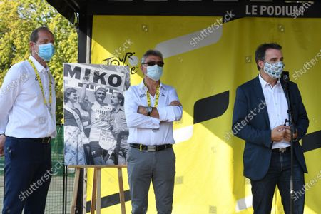 Stock Picture of Eric Piolle mayor of Grenoblet and Christian Prudhomme director of the tour de France in the village of the Tour for the big start of the 17th stage between Grenoble and Meribel in Savoie.