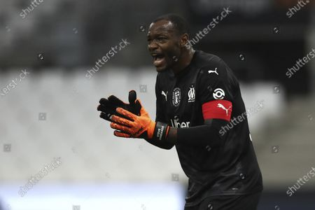 Marseille's goalkeeper Steve Mandanda gives instructions to his teammates during the French League One soccer match between Marseille and Saint Etienne at the Stade Velodrome in Marseille, France, Thursday, Sept.17, 2020