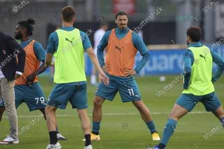 Milan's Zlatan Ibrahimovic, center, warms up prior to the start of an Europa League second qualifying round soccer match between Shamrock Rovers and AC Milan at the Tallaght Stadium in Dublin