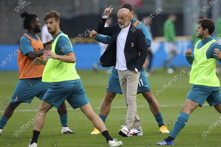 Milan's manager Stefano Pioli, center, talks with his player prior to the start of an Europa League second qualifying round soccer match between Shamrock Rovers and AC Milan at the Tallaght Stadium in Dublin