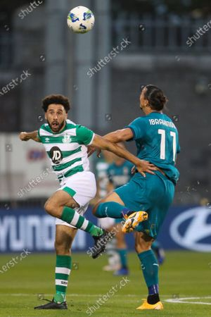 Shamrock Rovers 'Roberto Lopes, left, and AC Milan's Zlatan Ibrahimovic jump for the ball during an Europa League second qualifying round soccer match between Shamrock Rovers and AC Milan at the Tallaght Stadium in Dublin, in Dublin