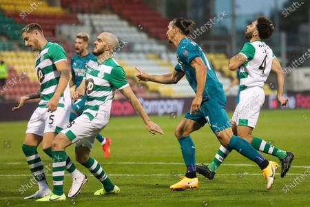 Milan's Zlatan Ibrahimovic, center, celebrates after he scored his side's first goal during an Europa League second qualifying round soccer match between Shamrock Rovers and AC Milan at the Tallaght Stadium in Dublin, in Dublin