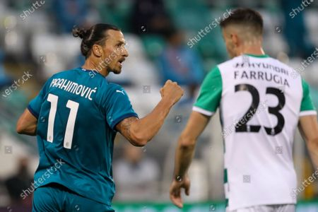 Milan's Zlatan Ibrahimovic, left, celebrates after he scored his side's first goal during an Europa League second qualifying round soccer match between Shamrock Rovers and AC Milan at the Tallaght Stadium in Dublin