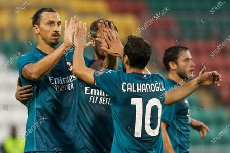 Milan's Zlatan Ibrahimovic, left, celebrates with his teammates after he scored his side's first goal during an Europa League second qualifying round soccer match between Shamrock Rovers and AC Milan at the Tallaght Stadium in Dublin