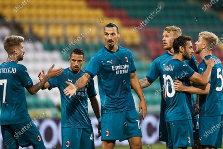 Milan's Zlatan Ibrahimovic, center, celebrates with his teammates after he scored his side's first goal during an Europa League second qualifying round soccer match between Shamrock Rovers and AC Milan at the Tallaght Stadium in Dublin